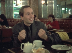 full-moon-in-paris-1984-001-fabrice-luchini-clenching-fists-delightedly-in-cafe_0
